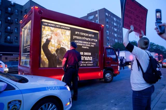 Cop greets the moving lit van.