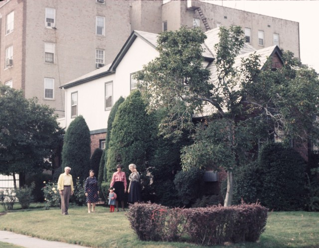 """The house where my Dad grew up, in Sheepshead bay. My grandpa on the left, Mom in the pink shirt with me, Grandma on the right. When asked about the apartment house behind, put up ten years after they moved in, my Grandma used to say, """"What apartment house?"""""""
